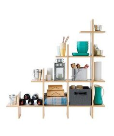 Unsure how to maximize that wedge of wasted space under the stairs? Turn it into storage for summer-party supplies with a deep modular unit that exploits every last inch.