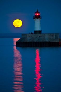 Lake Superior Lighthouse - I have seen this scene many times. Moonlight and lighthouse Beautiful Moon, Beautiful World, Beautiful Places, Images Cools, Cool Pictures, Beautiful Pictures, Lighthouse Pictures, Shoot The Moon, Beacon Of Light