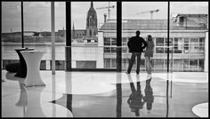 Frankfurt by Annette Soelter ( http://www.flickr.com/photos/annette_soelter/ ). I like her streetshots and her mirroring-series too. Worth a look!