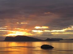 sunset view to Dokos island (shaped like a whale) from our terrace, Hydra house - Greece (Photo: Michel Le Goff )