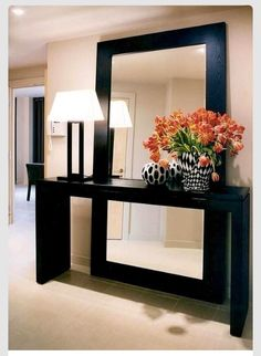 Modern yet elegant. Fill that empty foyer!