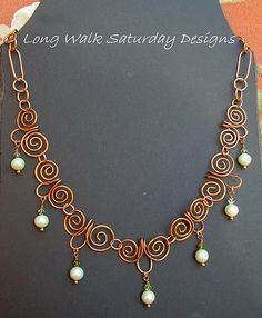 """Delightfully fun and delicate necklace! Hand formed Copper swirls boast soft green fresh water pearl dangles, with green Swarovski crystal accents enhancing each pearl. An excellent """"every day"""" wearable necklace, but also works ideally for that understated elegance look for evenings. Solid copper link chain, adjustable with a toggle from 16 to 20""""."""