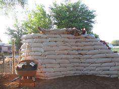 Great writeup on building earthbag garden walls, tons of photos.