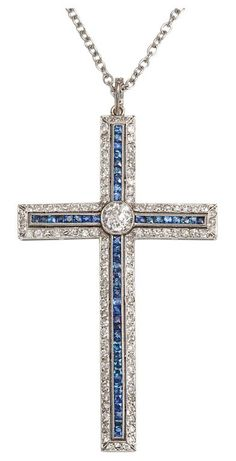 View this item and discover similar drop necklaces for sale at - Diamond  and sapphire cross pendant set in platinum. c7f1928c3aa