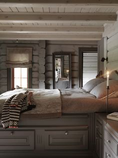 Love the bed..but for the millionth time...please, for the love of all that is holy, DON'T paint log walls!!!
