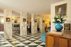 """In 1984 the building of Hotel Raffaello was bought by the Pecci family – still the present owners, and was completely restored. The interior of the building is completely clad in the famous Carrara """"Calacatta"""" and """"Alp Green"""" marble."""