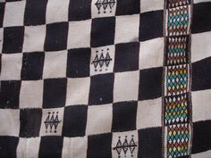 Very unusual early C20th blanket cloth from Mali. Cloths of this type were prestige items hung up for display at important events such as weddings rather than for everyday use. This example illustrates the early stages of the impact of a wider range of colours that would transform the appearance of Mailain blankets in the 1960s. Here just small quantities of green and red cotton are used within traditional patterns in place of the more muted colours of local dyes on a background design that…