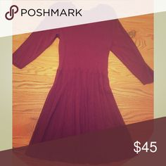 Burgundy sweater dress, three-quarter sleeve. Burgundy color, three-quarter sleeves... Falls right above the knee... Sweater material, but not super heavy... Shoulders are wide, tag states XL, but would describe it as more of a L... Only worn on a couple of occasions, all tags are in place (washing directions)... Thakoon Dresses Long Sleeve
