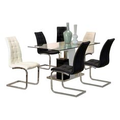 This dynamic Cramco Padria Dining Set in Black and White will fulfill all that your room has been missing. The set aims to reinvent your dining roo Table And Chairs, Dining Table, Dining Room, Adams Furniture, Contemporary Home Furniture, 7 Piece Dining Set, Nebraska Furniture Mart, Minimal Design, Seat Cushions