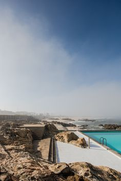 Designed by a young Álvaro Siza, the Boa Nova tea house and nearby swimming pools sustain an intimacy with the Atlantic by turning their back on land Office Building Architecture, Architecture Magazines, Portugal, Landscape Walls, Going Away, Underwater, Sustainability, Swimming Pools, Waves