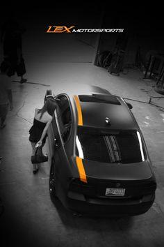 wrap, matte wrap, black wrap, black car, vehicle wrap, motorsports, car shop, cool car, orange stripe, vehicle modification, vehicle restyling
