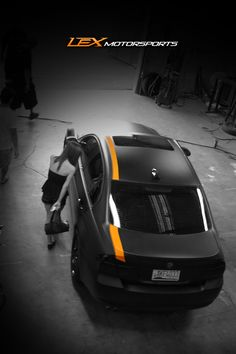 wrap, matte wrap, black wrap, black car, vehicle wrap, motorsports, car shop, cool car, orange stripe, vehicle modification, vehicle restyling