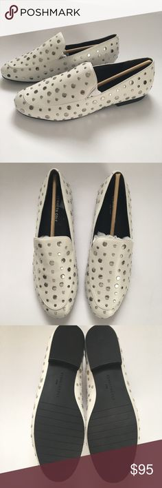 Gorgeous white with silver studs leather shoes Kenneth Cole New York white leather with silver studs flats. Brand new in box. Size 9 1/2 M. Kenneth Cole Shoes Flats & Loafers