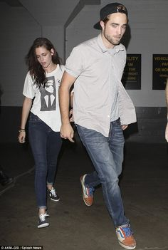 Kristen Stewart and Robert Pattinson kept it casual for a date at Hollywood's Hotel Cafe last night. Robert donned a cap bacwards to accentuate his relaxed feeling about the evening, while Kristen showed off her slender physique in a ripped T-shirt. Despite their relaxed sense of style, the couple looked terribly cute! via dailymail.co.uk