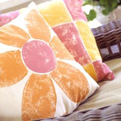 Painted Pillows ~ Painting on fabric for pillows is easy: Draw a design in chalk, then fill in shapes with fabric paint (or acrylic paint mixed with fabric painting medium) using a slightly dry brush and quick strokes to allow the canvas to show through. Painting a different design on each side makes the pillows conveniently reversible