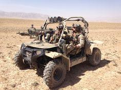 Friend of mine downrange rocking the RZR and M134 Minigun