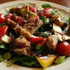 Spinach Salad with Pistachio Chicken | Tender slices of pistachio encrusted chicken top a spinach salad with sliced avocado, cherry tomatoes, and a bright balsamic dressing. Try it with field greens if you prefer.