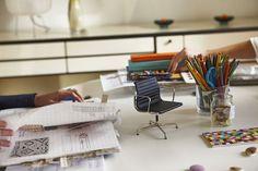 Take a seat  on the Eames Aluminium Chair.
