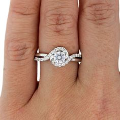 a twisted engagement ring made in white gold from A.Jaffe