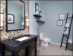 Love the idea of tile on the wall behind sink area complimented by the wall color for rest of it.  Love the lights done beside the mirrors as well.