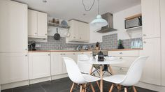 A dreamy creamy kitchen (with fab light) at Keigwin Cottage #luxurykitchen #cream #lighing #dining boutiqueretreat
