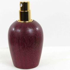 Atomiseur de parfum or 24 carat en bois exotique. Nature du bois exotique: Purple-Heart