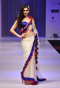 Interesting Edging White Sari Blue Satin border and Red Bunched Border Trendy Sarees, Stylish Sarees, Fancy Sarees, Saree Wearing Styles, Saree Styles, Indian Dresses, Indian Outfits, Saree Jackets, Modern Saree