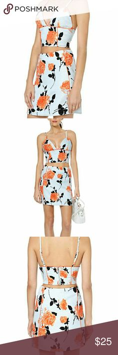 Nasty Gal MinkPink Queen's Garden Bustier This bustier has a super babely v-neckline, piping detail, and unique print with orange and contrasting shadow florals. Toughen it up with a leather skirt and ankle boots, or keep it sweet with a midi skirt and clutch! Zip closure.  *Polyester/Cotton? *Model is wearing size small? *Machine wash cold? *Imported Nasty Gal Tops Crop Tops