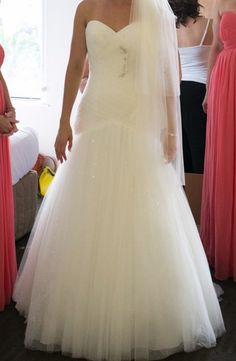 white strapless ruched tulle fit and flare wedding dress sweetheart neckline