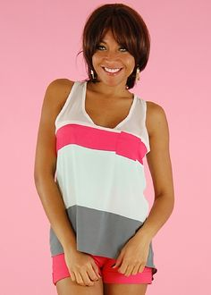 Flowy Tank Top. Be bold in colorblock! Colorful and vibrant, these blocks of color add style to this tank. Racerback. Hi-Lo silhouette. Loose fit. Single chest pocket. Made from 100% Polyester. Length from underarm down is 16.5 (measured from a size Small). Accessories Sold separate. Price: $14.99