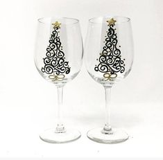 Set of two elegant hand painted Christmas Wine glasses are green christmas trees and Gold shimmery ornaments and a Gold Star on top! Great for that special holiday dinner or gift. Description • This listing is for a set of 2 Stemmed wine glasses • These Wine Glasses are 9 inches