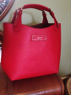 Dkny saffiano leather mini n/s tote in red... From TJ Maxx.   They had several styles and even a huge version of this bag... Would be nice for work or travel.