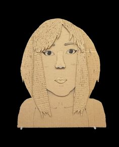 15 Cardboard Portraits by 12th Graders.