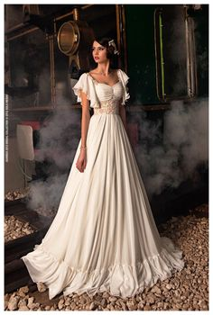 """So may wedding gowns would be beautiful, if only the weren't white or """"champagne"""" or """"ebony"""" (all of which are basically white!) or pink."""