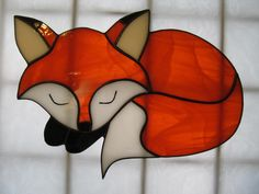 This is an original model drawn for me by my daughter several years ago. The sleeping fox suncatcher stained glass measures 9 wide x 7 high and was made using the copper leaf stained glass method. Each creation of stained glass is handcrafted in my Stained Glass Ornaments, Stained Glass Birds, Stained Glass Christmas, Stained Glass Suncatchers, Faux Stained Glass, Stained Glass Panels, Stained Glass Projects, Leaded Glass, Mosaic Glass