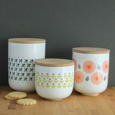 Beautiful retro style canisters with a fresh design.These sturdy ceramic canisters are perfect for storing your tea, coffee, sugar, hot chocolate, marshmallows...you name it! Their juicy colour palette is very fashionable at the moment. Three designs to pick from, each in a different size. We also sell matching ceramic mugs, check our other listings. We wouldn't recommend washing these in the dishwasherCeramic and woodDiameter: 12 cm Height: Small - 11.5cm, Medium 14.5cm, Large 17.5cm