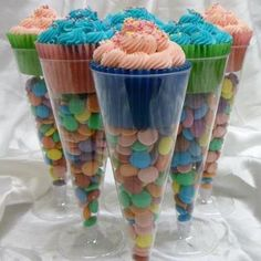 Eye-catching idea: cheap dollar store plastic champagne flutes filled with colorful candies and a cupcake on top. Adorable and yummy!