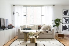 """""""I placed the white Ikea Besta units down the length of the living/dining room wall as I wanted to create a floor plan that welcomed people and was free flowing."""""""