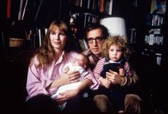 Actress Mia Farrow holding son Satchel with Satchel's father, actor/director Woody Allen, holding Farrow's daughter Dylan
