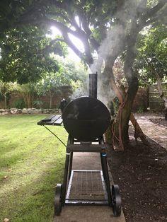 Offset smoker under Magnolia tree