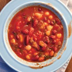 Stewed Beans Recipe Main Dishes with olive oil, garlic, yellow onion, red bell pepper, jalapeno chilies, tomato paste, dried thyme, dried oregano, chile powder, paprika, dried kidney beans, dried pinto beans, garbanzo, hand, juice, peel tomato whole, cilantro, kosher salt, ground black pepper