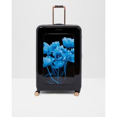 Ted Baker Blue Beauty large suitcase (6,625 EGP) ❤ liked on Polyvore featuring bags, luggage and black