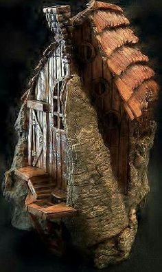 Cottonwood bark house carved by N. Minske.