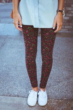 Wear a light blue denim shirt with black floral leggings for a casual get-up. This outfit is complemented perfectly with white canvas low top sneakers.   Shop this look on Lookastic: https://lookastic.com/women/looks/light-blue-denim-shirt-black-floral-leggings-white-canvas-low-top-sneakers/17377   — Light Blue Denim Shirt  — Black Floral Leggings  — White Canvas Low Top Sneakers
