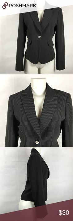 "Tahari Arthur S Levine Pin Stripe Blazer Size 4P Tahari Arthur S Levine Pin Stripe Blazer Black Size 4P Coat Jacket Career Work Wear Casual  Item Description/Specifics: • Pre-owned, item is gently used • Size: 4P • Pin stripe, 1 button front, faux side pockets • Shoulder to shoulder: 15.5"" unstretched • Sleeve length: 23.5"" unstretched • Armpit to armpit: 17.5"" unstretched • Waist: 15"" unstretched • Length: 22"" unstretched  Stock#: NB Tahari Arthur S Levine Jackets & Coats Blazers"