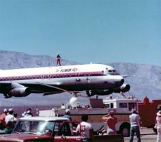 Santa rides a DC-8 in a very low pass