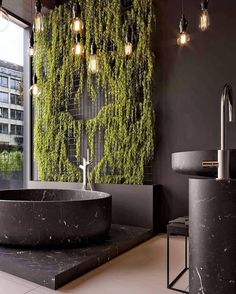 LOFT on Extraordinary black marble bathtub with an beautiful plant wall . This bathroom is definitely a displaying the hottest interior trends for Black Marble Bathroom, Marble Bathtub, Marble Bathrooms, Zebra Bathroom, Bling Bathroom, Paris Bathroom, White Bathrooms, Shower Bathroom, Vanity Bathroom