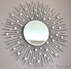 Please note - Orders placed after Dec 9 will ship in January 2016.  The center mirror is surrounded by wood rods, faux finished to look like metal. Lots of little mirrors give the rods a beautiful and dazzling aesthetic. Comes with sawtooth hanger in the back for easy hanging.  Pictures show the basic color options available - Metallic black, Gold, Silver and Bronze. I can also do many other colors for a nominal additional charge. Also, can be made in other sizes. Please contact me!  Most…
