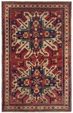 """Caucasian Eagle Kazak (Chelaberd Karabagh) - 4ft 5in x 6ft 8in, Dated 1875. An excellent representative of one of the most sought after collectible rare antique Caucasian rug styles, this stunning Eagle Kazak is a very exciting acquisition. Consuming much of the field, the """"Sunburst"""" medallions are delightfully asymmetrical, seeming to burst out of the rug's narrow, naively rendered frame. A rare profusion of ripe apple green highlights the medallions & appears prominently in the border…"""