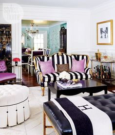 Fun beautiful french living room with hermes throw and a black and white striped French sofa. French decor ideas, loft, eclectic, living room, family room, fireplace ideas wild fun design furniture diy